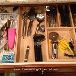 Here's my drawer for eating utentils. I also keep a few tea knick knacks in there. I have two more drawer equally uninspiring.