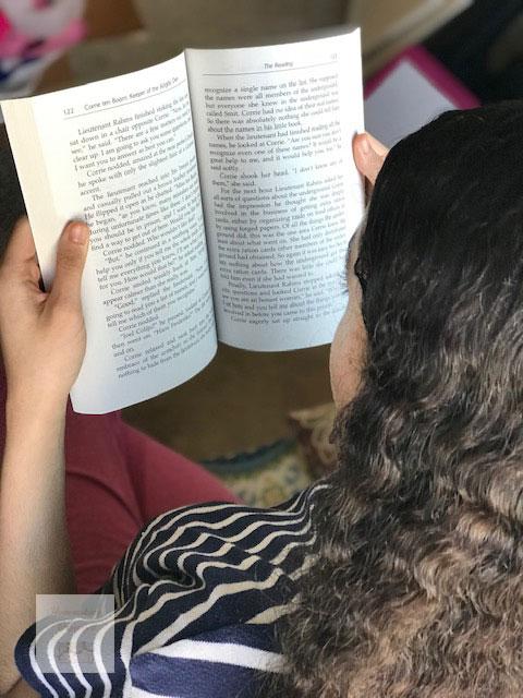 Reading Corrie Ten Boom by YWAM Publishing.