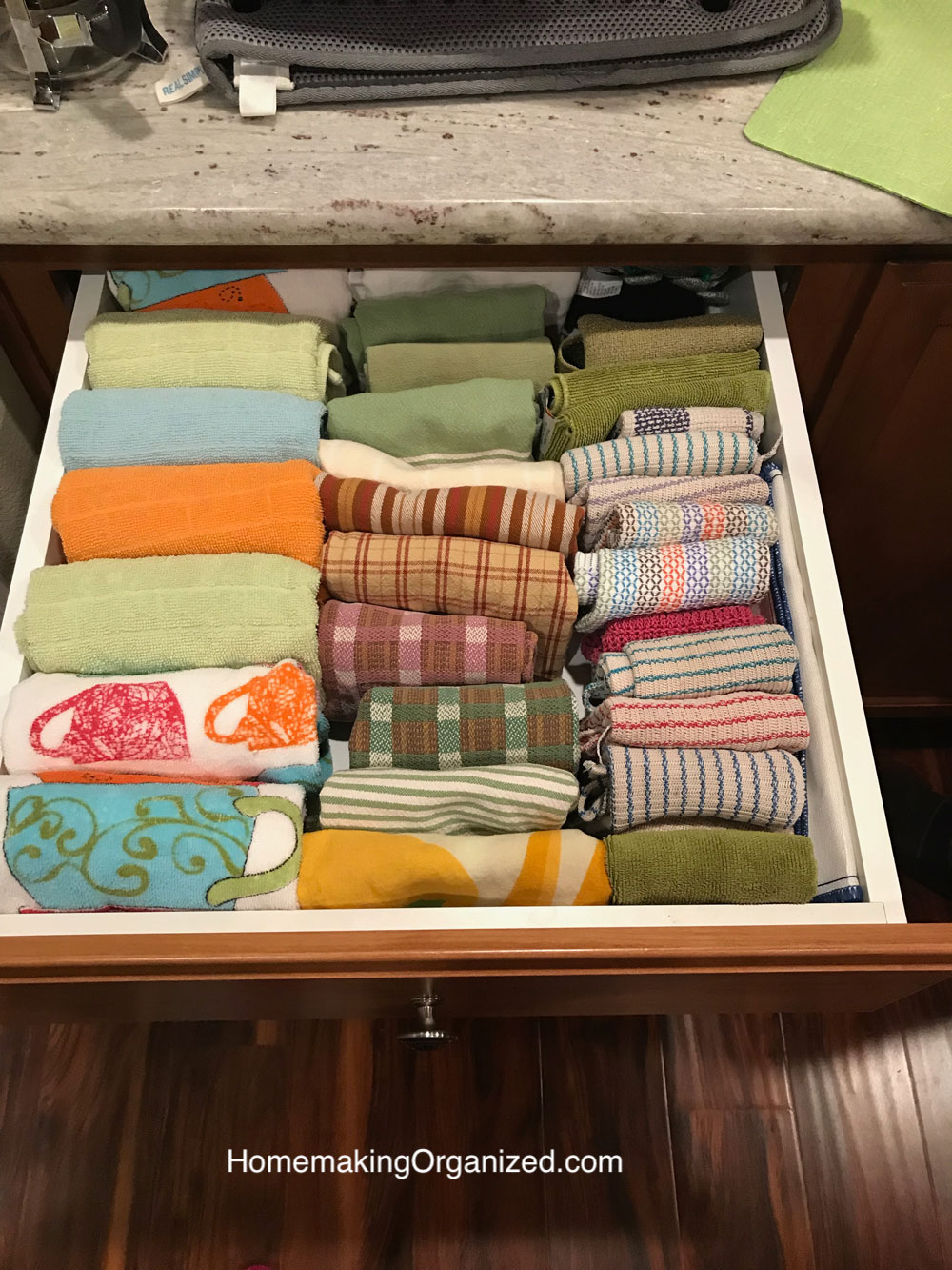 Kitchen linens folded in a drawer Marie Kondo Style.