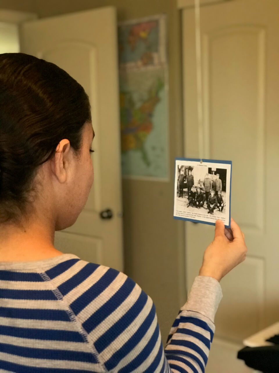 Hanging historical pictures in our homeschool room for a Exploring the US Life Saving Service activity.